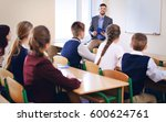 pupils listening teacher in... | Shutterstock . vector #600624761