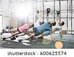 people exercising with... | Shutterstock . vector #600625574