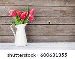 red tulips bouquet in front of... | Shutterstock . vector #600631355