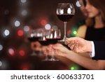 male hand taking wine glass...   Shutterstock . vector #600633701
