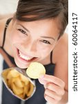 Woman Eating Chips. Beautiful...