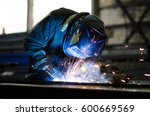 welders working at the factory... | Shutterstock . vector #600669569