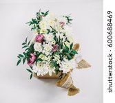 tender peonies and roses put in ... | Shutterstock . vector #600688469
