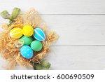 easter eggs in the nest. rustic ... | Shutterstock . vector #600690509