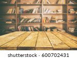 wooden table in the library | Shutterstock . vector #600702431