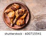 grilled chicken drumsticks in... | Shutterstock . vector #600715541