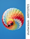 Small photo of Hot air balloon, colorful aerostat on blue sky, low angle view