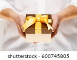 male hands holding a gift box.... | Shutterstock . vector #600745805