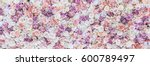 Stock photo flowers wall background with amazing red and white roses wedding decoration hand made toning 600789497