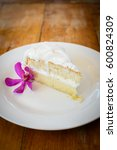 coconut cake on white plate and ... | Shutterstock . vector #600824309