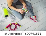 runner girl holding smart phone ... | Shutterstock . vector #600941591