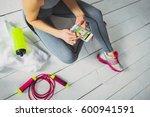 runner girl holding smart phone ... | Shutterstock . vector #600941591