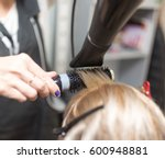 styling female hair dryer | Shutterstock . vector #600948881