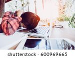overworked and tired young...   Shutterstock . vector #600969665