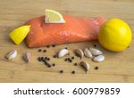 salmon fillet with garlic and... | Shutterstock . vector #600979859