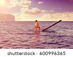 sup stand up surf girl with... | Shutterstock . vector #600996365