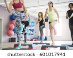 step aerobics in health club  | Shutterstock . vector #601017941