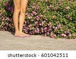 young woman legs wearing flip... | Shutterstock . vector #601042511