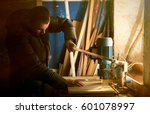 man doing some carpentry work... | Shutterstock . vector #601078997