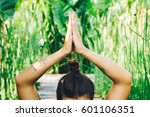 young woman practicing yoga... | Shutterstock . vector #601106351