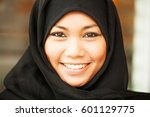 smiling young woman wearing... | Shutterstock . vector #601129775