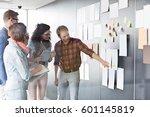 young businessman explaining... | Shutterstock . vector #601145819