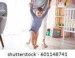 cute boy taking first steps... | Shutterstock . vector #601148741