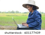 asian thai farmer using laptop... | Shutterstock . vector #601177439