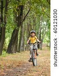 Young Boy Riding Bicycle In A...