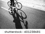 shadow of a woman riding bike... | Shutterstock . vector #601238681