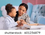 attentive kind mom giving her... | Shutterstock . vector #601256879