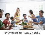 a family gathering for a meal... | Shutterstock . vector #601271567