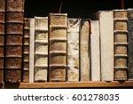 vintage books on wooden shelf. | Shutterstock . vector #601278035