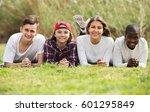 group of joyful smiling teenage ...