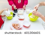 young happy family making food... | Shutterstock . vector #601306601