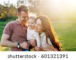 young happy family walking...   Shutterstock . vector #601321391