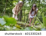 two girls playing at a pond in... | Shutterstock . vector #601330265