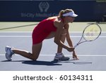 CARLSBAD, CA - AUGUST 07: Maria Kirilenko waits for her partner's serve in a doubles exhibition at the Mercury Insurance Open at La Costa Resort and Spa on August 7, 2010 in Carlsbad, CA. - stock photo