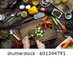 slicing by hand cucumber on... | Shutterstock . vector #601344791