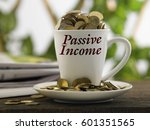 Small photo of white mug written passive income with coins inside, finance conceptual.