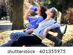 two young woman sitting on... | Shutterstock . vector #601355975