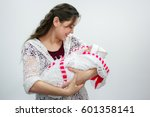 young mother holding newborn...   Shutterstock . vector #601358141
