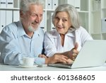 elderly couple with a laptop | Shutterstock . vector #601368605