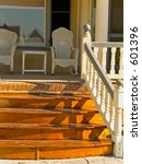 This is a shot of some wicker furniture on a nice old fashioned porch. - stock photo