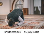 muslim man prostrating on the... | Shutterstock . vector #601396385