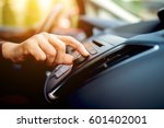 turning on radio at car driving ... | Shutterstock . vector #601402001