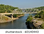 Highway bridge over French River in Ontario - stock photo