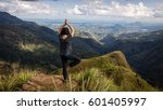 woman doing yoga on top of... | Shutterstock . vector #601405997