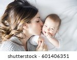 a mother and baby child on a... | Shutterstock . vector #601406351