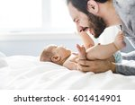 a happy father playing with... | Shutterstock . vector #601414901